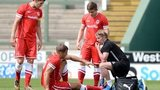 Cardiff City's Ben Turner receives treatment