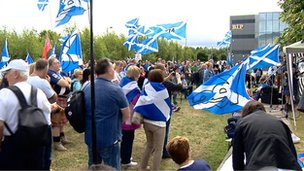 Supporters of a yes vote in September's independence referendum gather near the BBC's Pacific Quay building