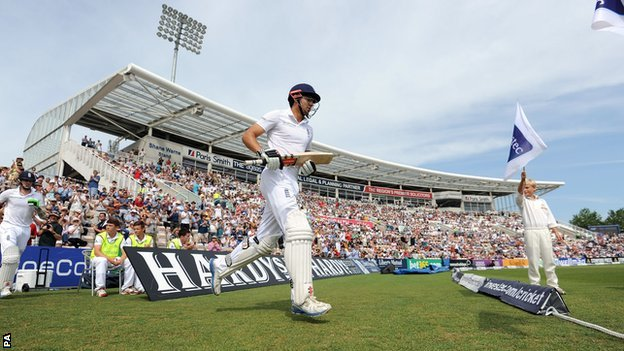 Alastair Cook walks out to bat