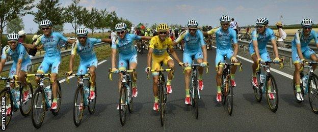 Vincenzo Nibali (in yellow) and his Astana team-mates on the final ride to Paris