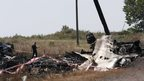 A Malaysian air crash investigator works at a crash site of the Malaysia Airlines Flight MH17 near the village of Hrabove (Grabovo), Donetsk region on 24 July 2014.