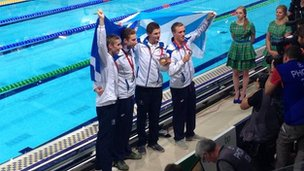 Team Scotland celebrate silver in the 4x200m relay