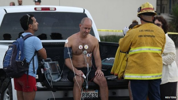 A man is treated by a paramedics after a lightning strike in the water in Venice