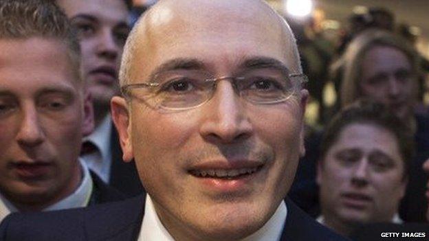Mikhail Khodorkovsky leaves a press conference in Berlin.