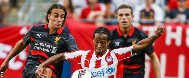Lazar Markovic (left) made his first appearance for Liverpool in the game against Olympiakos