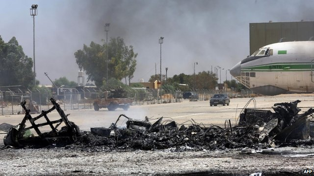 The remains of a burnt airplane at the Tripoli international airport in the Libyan capital on 16 July 2014.