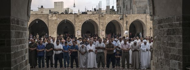Palestinian Muslims mark Eid al-Fitr in Gaza City, 28 July