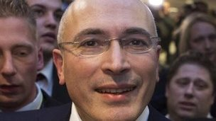 Mikhail Khodorkovsky leaves a press conference in Berlin.