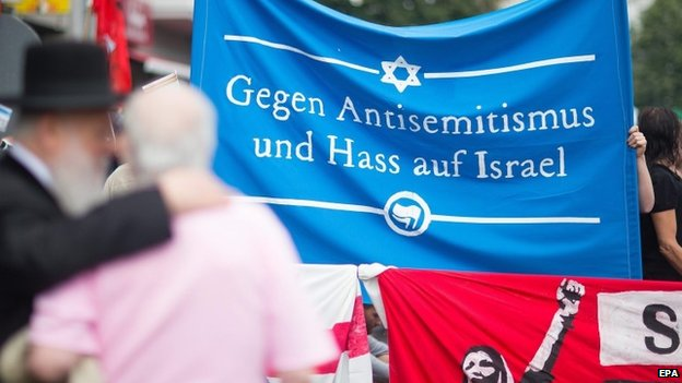 Berlin activists with a banner saying 'Against anti-Semitism and hatred of Israel'
