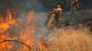 Fire fighters battle a spot fire near Plymouth, California (26 July 2014)