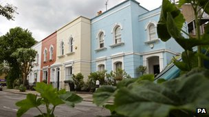 A street of colourfully painted houses in London