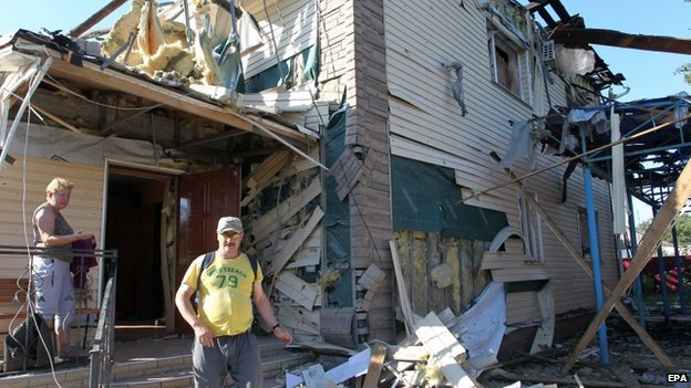A man stands in rubble of a damaged house in Horlivka, Ukraine, on 27 July 2014.