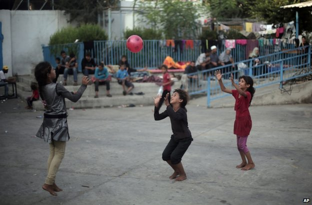 Palestinian children play at a UN school in Jabaliya refugee camp, Gaza, 28 July