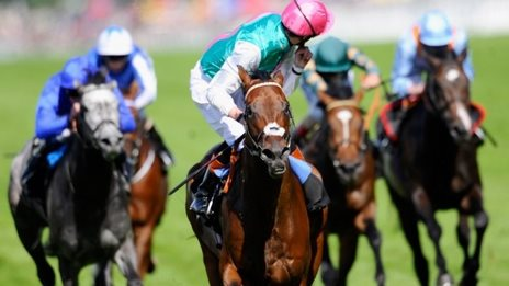 Jockey James Doyle, riding Kingman, celebrates winning the St James's Palace Stakes at Royal Ascot