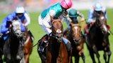 Jockey James Doyle, riding Kingman, celebrates winning the St James's Palace Stakes at Royal Ascot