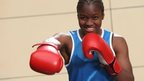 England's Nicola Adams poses for the camera