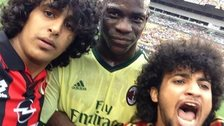 Mario Balotelli poses with two AC Milan fans in Pittsburgh
