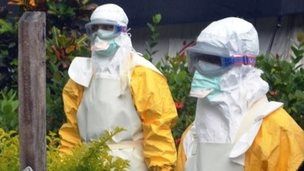 MSF Ebola workers wearing protective clothing - 23 July 2014 - in Guinea