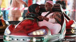 Muslims riding a bumper car