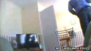 CCTV showing a computer being taken