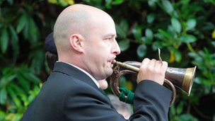 man playing bugle