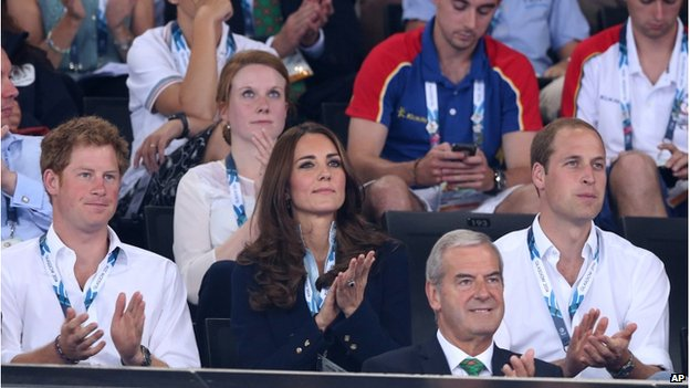 Prince William (right),with his wife Kate and Prince Harry (left) watch the early rounds of the gymnastics