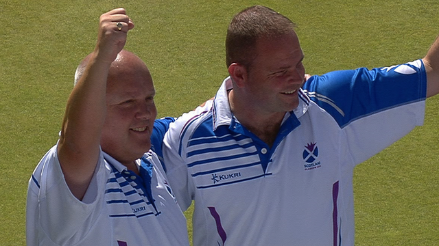 Scotland bowlers Paul Foster and Alex Marshall celebrate beating Malaysia