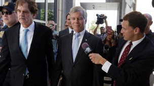 Former Virginia Governor Robert F. McDonnell, centre, with his attorney Henry W Asbill, left, arrive at the federal courthouse in Richmond, Virginia, 28 July 2014