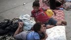 Palestinian children rest on the floor at a UN school in Jabaliya refugee camp, Gaza, 28 July
