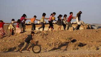Displaced Syrian children play