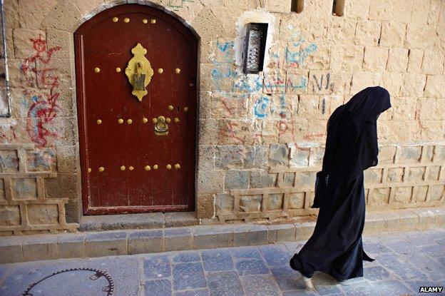 Woman walks away from a shut door