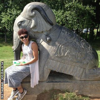 Jodie Williams sits next to an elephant statue