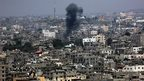 Smoke rises after an Israeli airstrike in the east of Gaza City, 28 July 2014