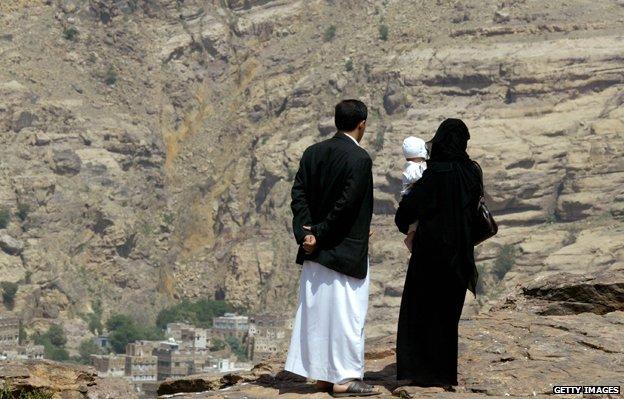 Yemeni couple holding child