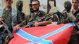 Separatist troops in Donetsk with Novorossiya flag