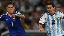 Muhamed Besic and Lionel Messi