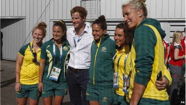 Prince Harry with players from the Australian hockey team during the Commonwealth Games in Glasgow