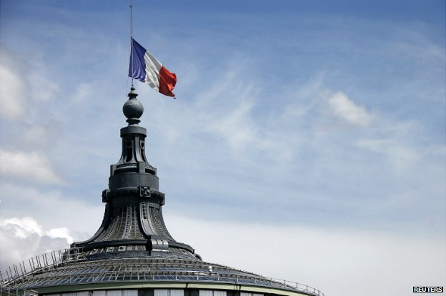 A French flag flying half-mast at the Grand Palais in Paris - 28 July 2014