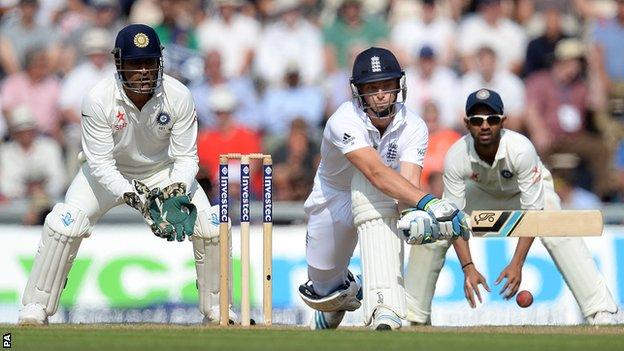 England's Jos Buttler reverse-sweeps