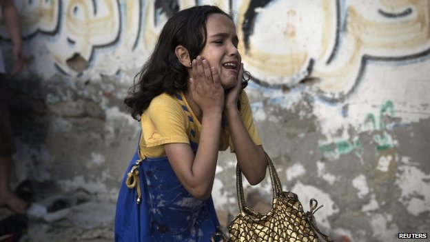 A Palestinian girl at the scene of an explosion that medics said killed eight children and two adults at a public garden in Gaza City