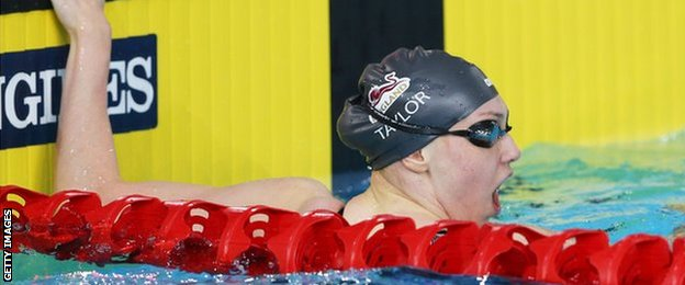 Sophie Taylor of England reacts after winning 100m breaststroke gold