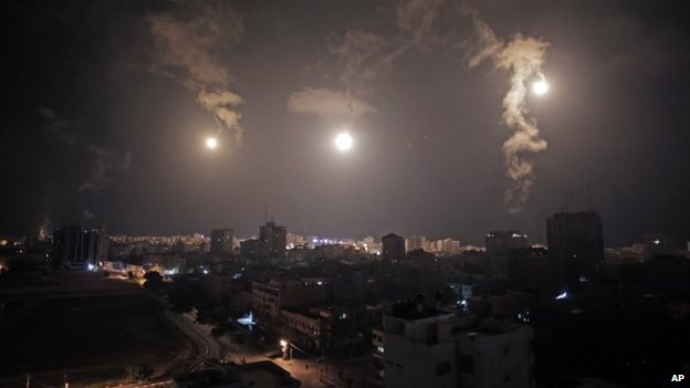Israeli forces' flares light up the night sky of Gaza City on early Tuesday, 29 July 2014