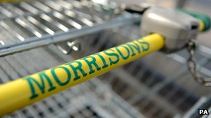Signage for Morrisons supermarket on a trolley handle