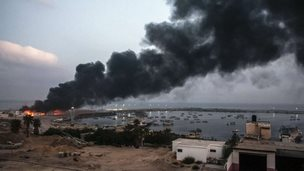 A building within the Gaza port is seen on fire after several strikes early on July 29, 2014