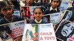 Children in a silent protest against sexual harassment of children, in Bangalore, India, 22 July 2014