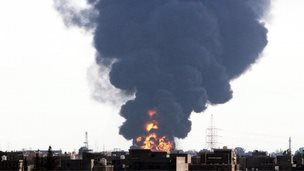 Black smoke billows from a fuel storage depot near the airport in Tripoli, Libya, 28 July 2014, after it was hit by a rocket fire