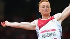 Greg Rutherford competes in the long jump at Hampden Park