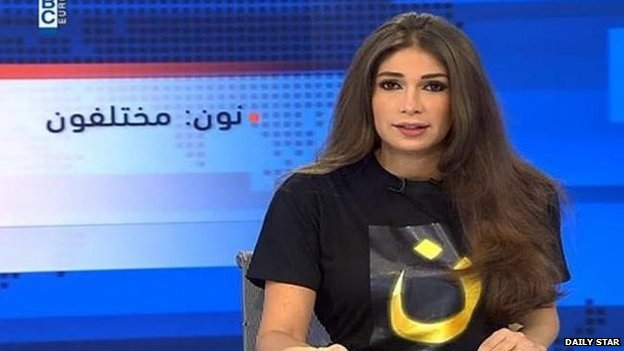 Screenshot of Dima Sadeq wearing a T-shirt in solidarity with Christians