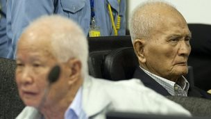 Former Khmer Rouge leader  Khieu Samphan (L) and  Nuon Chea (R) in the courtroom at ECCC in Phnom Penh on October 31, 2013