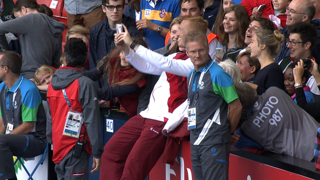 English long jumper Greg Rutherford poses with fans